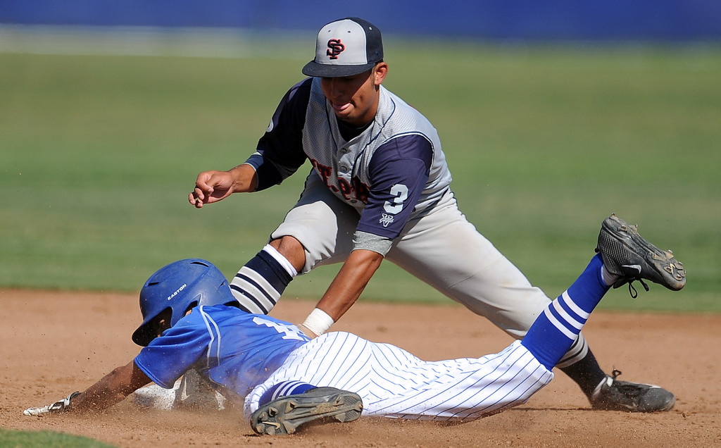. St. Paul\'s Larson Anzaldo (3) tags out Bishop Amat\'s Christian Moya at second base in the second inning of a prep baseball game at Bishop Amat High School on Friday, April 19, 2012 in La Puente, Calif. Bishop Amat won 3-2.    (Keith Birmingham/Pasadena Star-News)