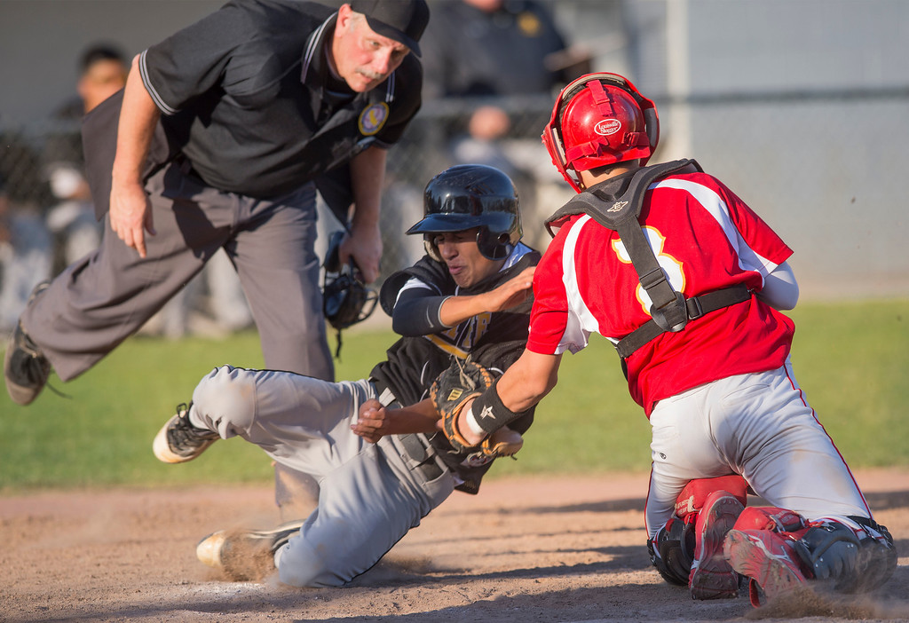 . Santa Fe High\'s Jacob Ortiz is tagged out at home by Whittier Christian High catcher Cooper Hughes during the sixth inning at Biola University\'s field in La Mirada March 12, 2013.  (SGVN/Staff photo by Leo Jarzomb)