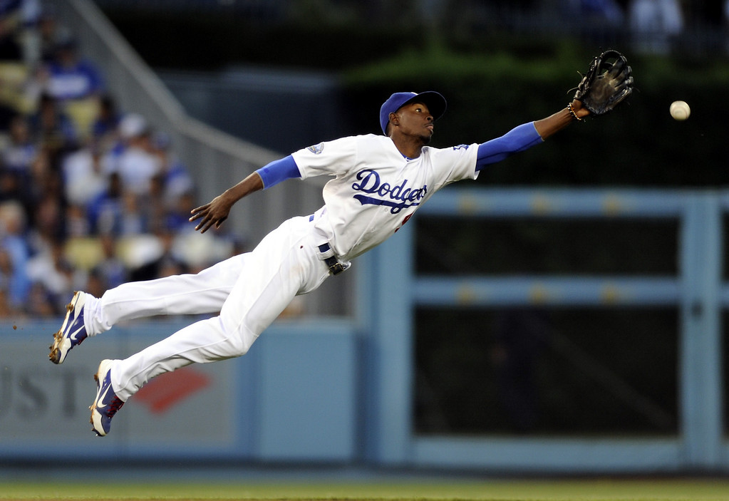 . Dodgers shortstop Dee Gordon just misses a line drive by the Chicago White Sox\' Gordon Beckham in the third inning, Saturday, June 16, 2012, at Dodger Stadium. (Michael Owen Baker/Staff Photographer)