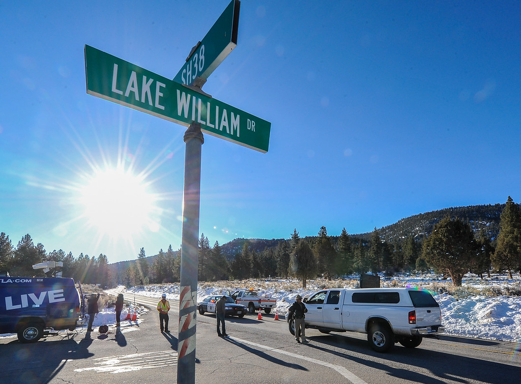 . (Rachel Luna / Staff Photographer)Highway 38 remains closed to media and civilian traffic near Lake William Drive in Big Bear City on Wednesday, Feb. 13, 2013. Highway 38 remained while law enforcement investigated the crime scene where it is believed Christopher Dorner barricaded himself in a cabin near Highway 38 in Barton Flatts on Wednesday.  (Rachel Luna / Staff Photographer)