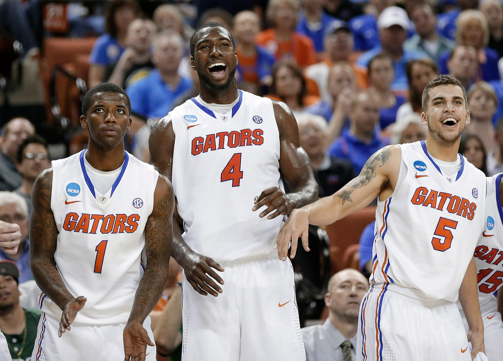 . Florida\'s Kenny Boynton (1), Patric Young (4), and Scottie Wilbekin (5) watch during the final moments of a second-round game of the NCAA men\'s college basketball tournament Friday, March 22, 2013, in Austin, Texas. Florida defeated Northwestern State 79-47. (AP Photo/Eric Gay)
