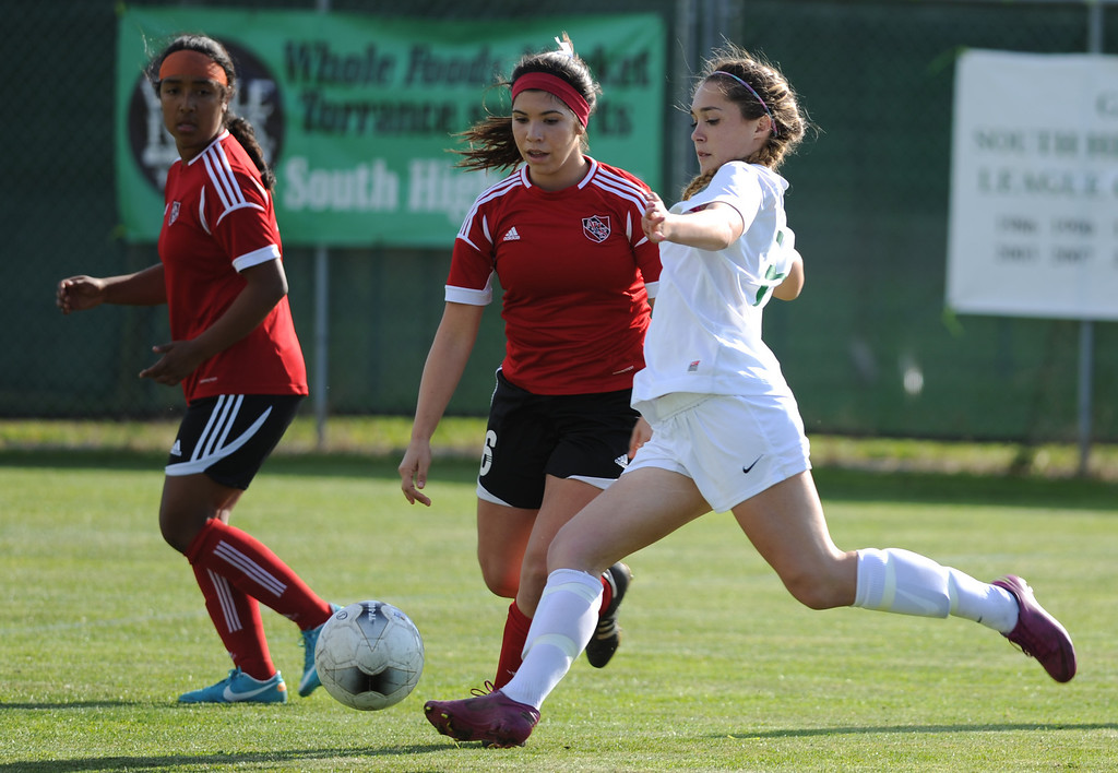 . 02-21-2012--(LANG Staff Photo by Sean Hiller)- South Torrance girls soccer beat Artesia 5-0 in Thursday\'s CIF Southern Section Division IV quarterfinal at South High. South\'s Hayley Suart (3) moves the ball ahead of Artesia\'sAriel Burns (6).