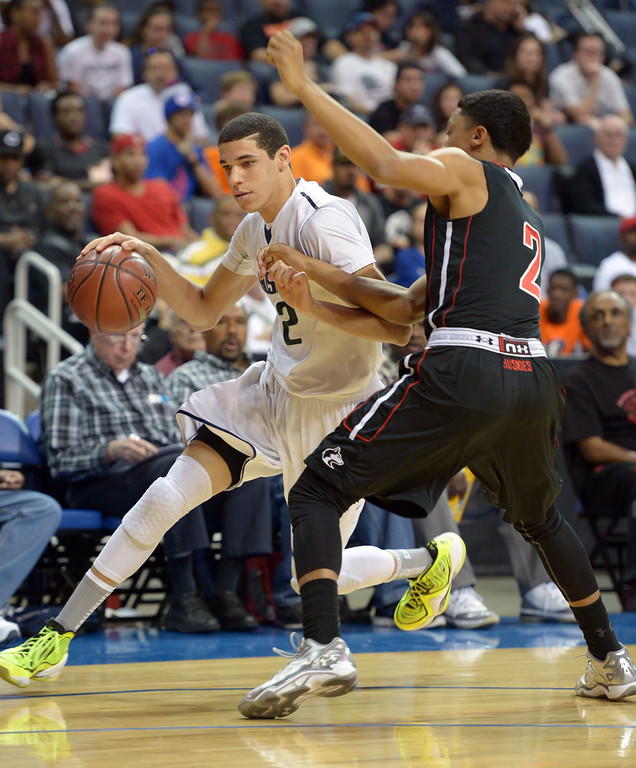 . Chino Hills\' Lonzo Ball drives around Centennial\'s Sedrick Barefield at Citizens Business Bank Arena in Ontario, CA on Saturday, March 22, 2014. Chino Hills vs Centennial in the CIF boys Div 1 regional final. 1st half. Photo by Scott Varley, Daily Breeze)
