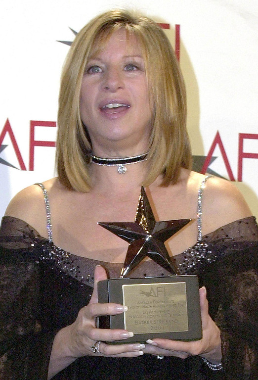 . US singer/actress/director Barbra Streisand poses with the American Film Institute\'s Life Achievement Award backstage before a gala tribute dinner in Beverly Hills, 22 February 2001.    (LUCY NICHOLSON/AFP/Getty Images)