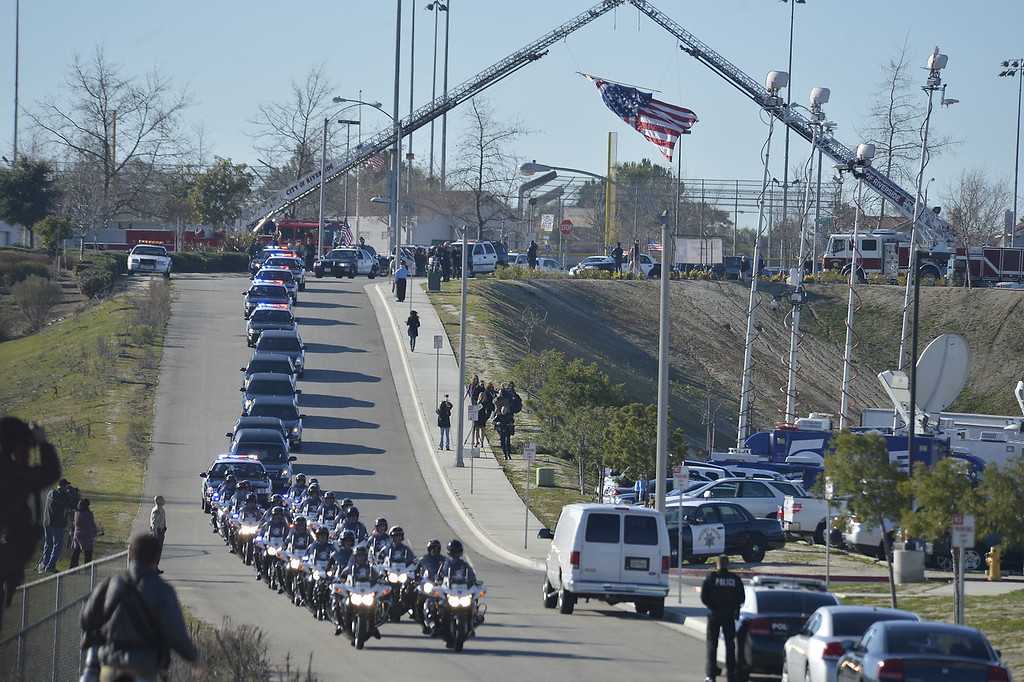 Description of . Today's funeral for fallen Riverside police Officer Michael Crain to draw thousands, including Gov. Jerry Brown.  The service, to be held at 10:30 a.m. at Grove Community Church, 19900 Grove Community Drive in Riverside, has increased security.  (Jeff Gritchen/Staff Photographer)