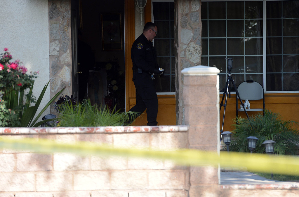 Description of . Pomona Police investigate the scene of a murder-suicide in the 2100 block of north Ramsey Way in Pomona, CA, Friday, May 9, 2014. (Jennifer Cappuccio Maher/Inland Valley Daily Bulletin)