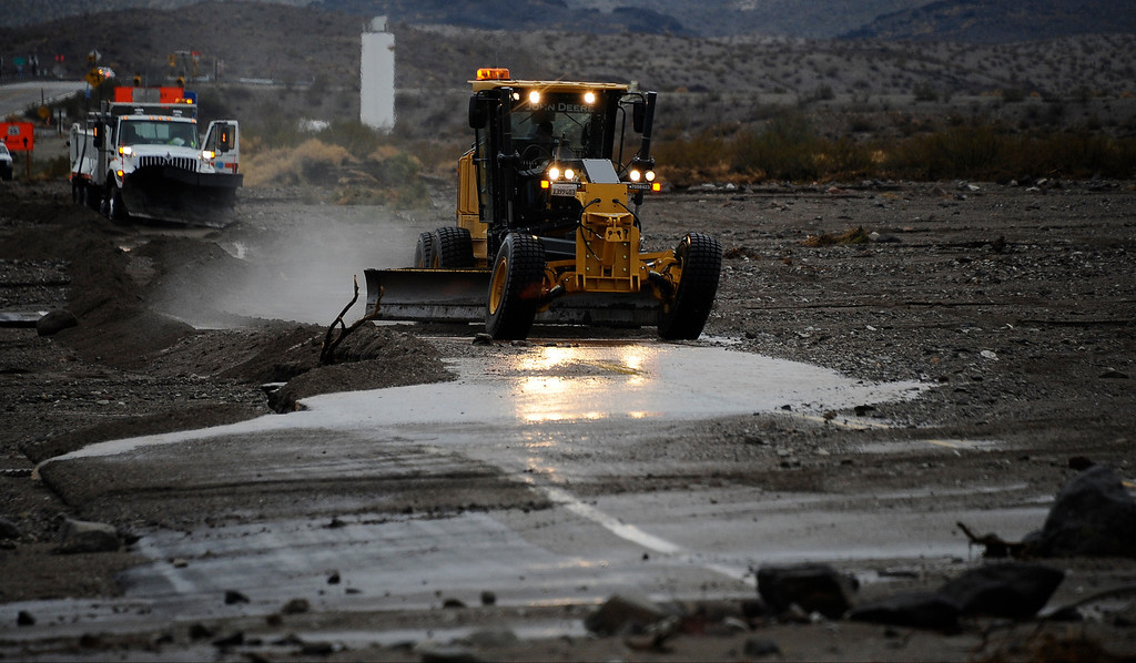 . Drivers in cars and semi trucks got stuck on highway 95 just north of highway 40 west of Needles California Sunday afternoon. Drivers were stuck for hours until Caltrans arrived late in the evening to start to remove the mud that came from heavy monsoon storms today in the deserts areas. Needles CA, Aug 25,2013. Photo by Gene Blevins/LA Daily News