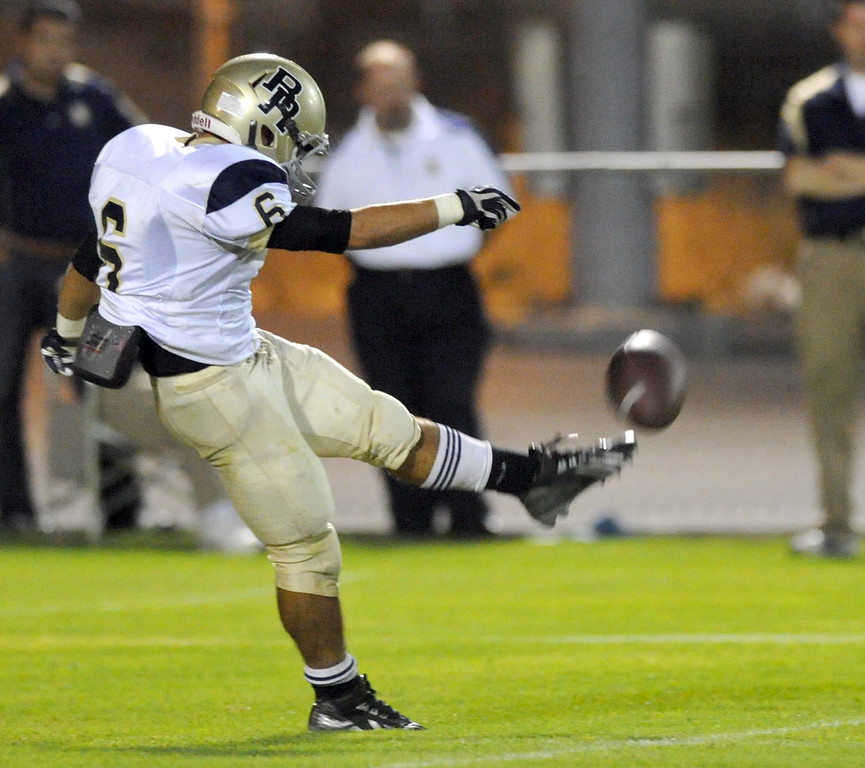 Description of . Rowland's Brandon Baisley (#6) punts the ball as they play Northview in their non-league game at Covina District Field in Covina on Friday September 13, 2013. Northview beat Rowland 28-0. (San Gabriel Valley Tribune/Staff Photo by Keith Durflinger)