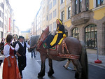 Every year, the parade is led by the M�nchener Kindl, a symbolic representation of the city of Munich as a child. Wearing a black and yellow monk's tunic and riding a grey horse, she carrie ...