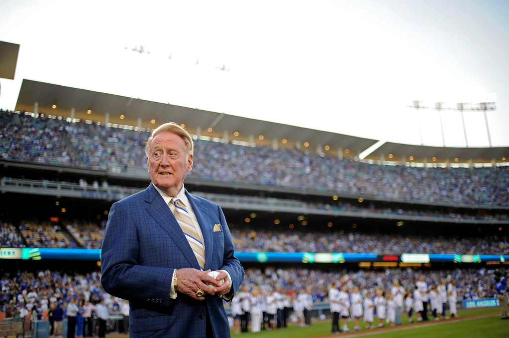 . Vin Scully waits to throw out the first pitch on  Vin Scully Bobblehead Night at Dodger Stadium in Los Angeles Thursday, August 30, 2012. (Hans Gutknecht/Staff Photographer)