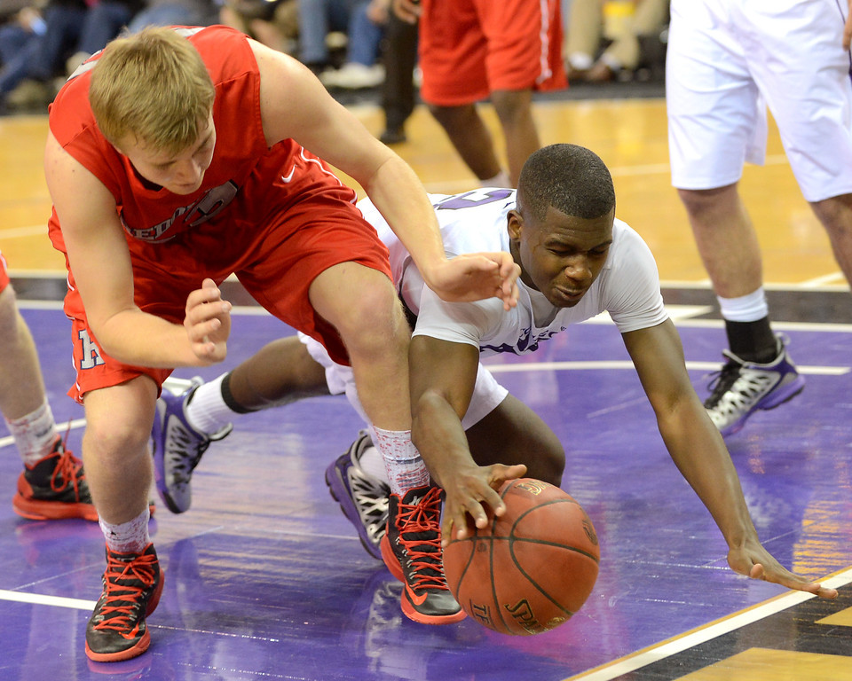 . Redondo Union High School\'s Derek Biale and AJ Newellor of of College Park High School chase down a loose ball during the Division II 2013 CIF State Basketball Championships at Sleep Train Arena, in Sacramento, Ca March 23, 2013.  Redondo won the game 54-47.(Andy Holzman/Los Angeles Daily News)