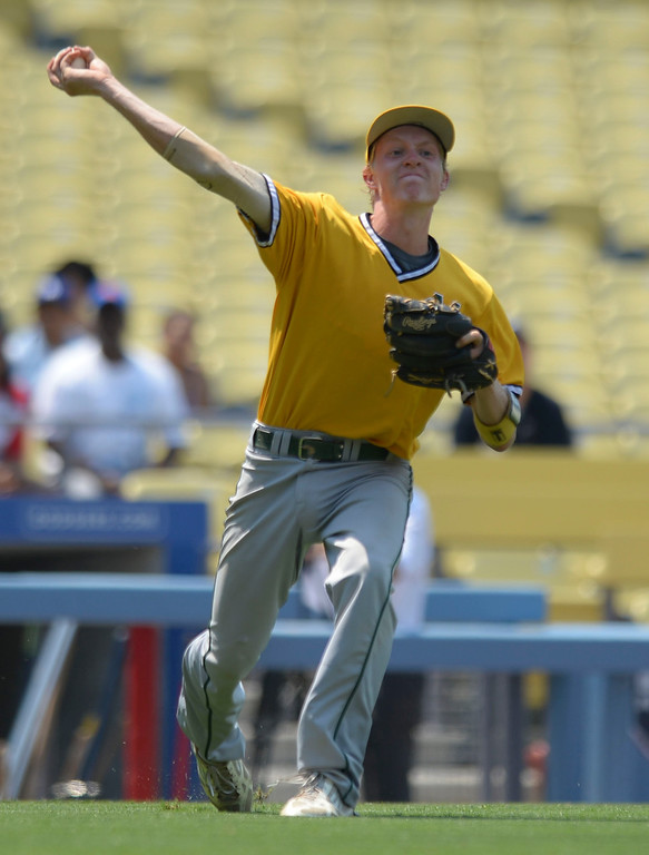 . Mira Costa\'s Braden Casady (8) makes the throw to first against Serra in the CIF-SS Division III championship baseball game Friday at Dodger Stadium. Serra won the title, 8-1. 20130531 Photo by Steve McCrank / Staff Photographer