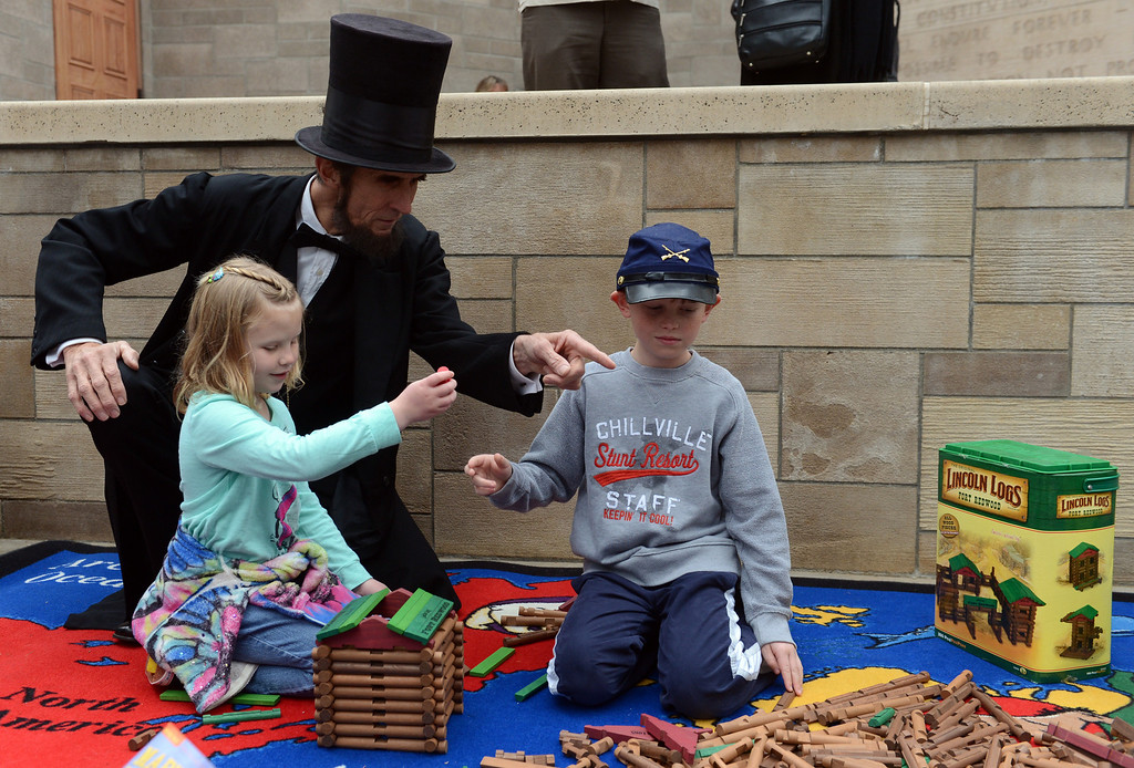 ". Abraham Lincoln, played by Robert Broski, of Covina, asks Alison Klemm, 7, and her brother Brian, 10, both of Mentone, about ""Lincoln Logs\"" during the Lincoln Shrine\'s 42nd annual Open House at the Lincoln Shrine in Redlands, CA., Sunday, February 9, 2014. (Photo by Jennifer Cappuccio Maher/Inland Valley Daily Bulletin)"