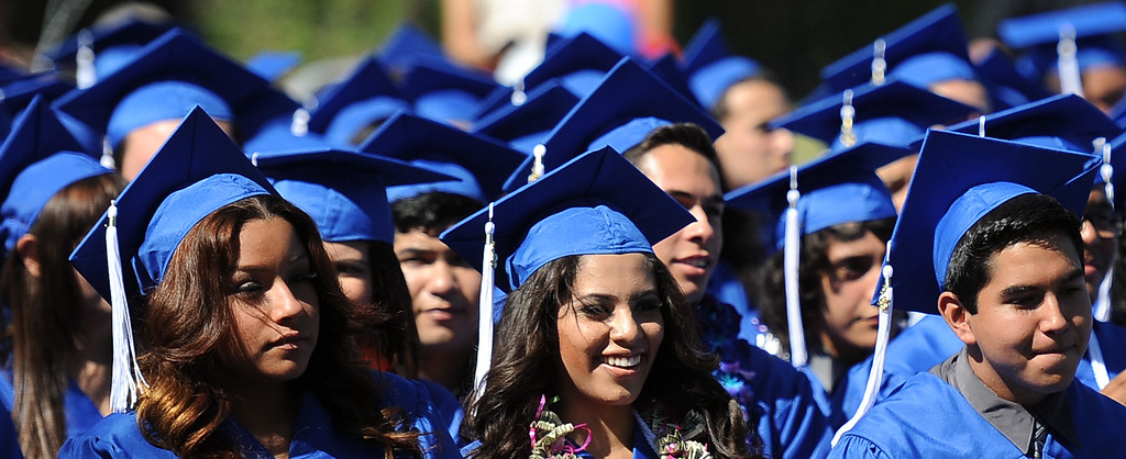 Description of . Students listen to speakers during the El Camino High School commencement at El Camino High School on Wednesday, June 19, 2013 in Whittier, Calif.  (Keith Birmingham/Pasadena Star-News)