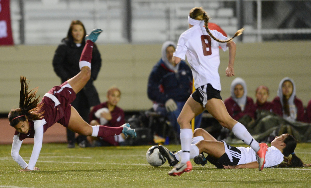 . Downey\'s Janeth Acuna (15) goes flying as Torrance\'s Melanie Brunk (5) slide tackles her in a CIF SS Division IV quarterfinal game Thursday at Zamperini Field. Downey won the game 3-1. 20130221 Photo by Steve McCrank / Staff Photographer