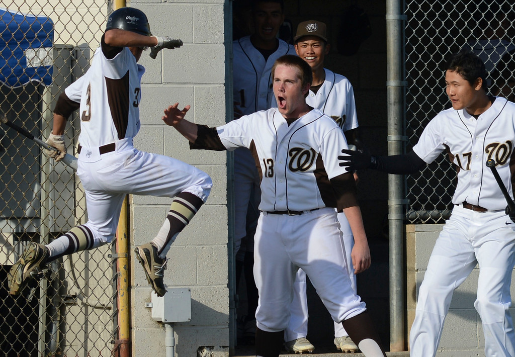 . West\'s Javier Galvan (3) is ecstatic as he celebrates his run, as West comes back on Torrance in the sixth, with Brandon Baker (13) and Young Kyu Lee (17) against Torrance in a non league baseball game at West. After a scoreless game through five, West went on to win 7-4. 0130314 Photo by Steve McCrank / Staff Photographer
