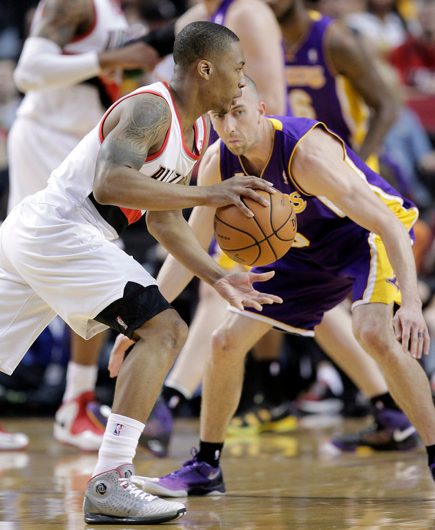 . Portland Trail Blazers guard Damian Lillard, left, drives on Los Angeles Lakers guard Steve Blake during the first quarter of an NBA basketball game in Portland, Ore., Wednesday, April 10, 2013.(AP Photo/Don Ryan)