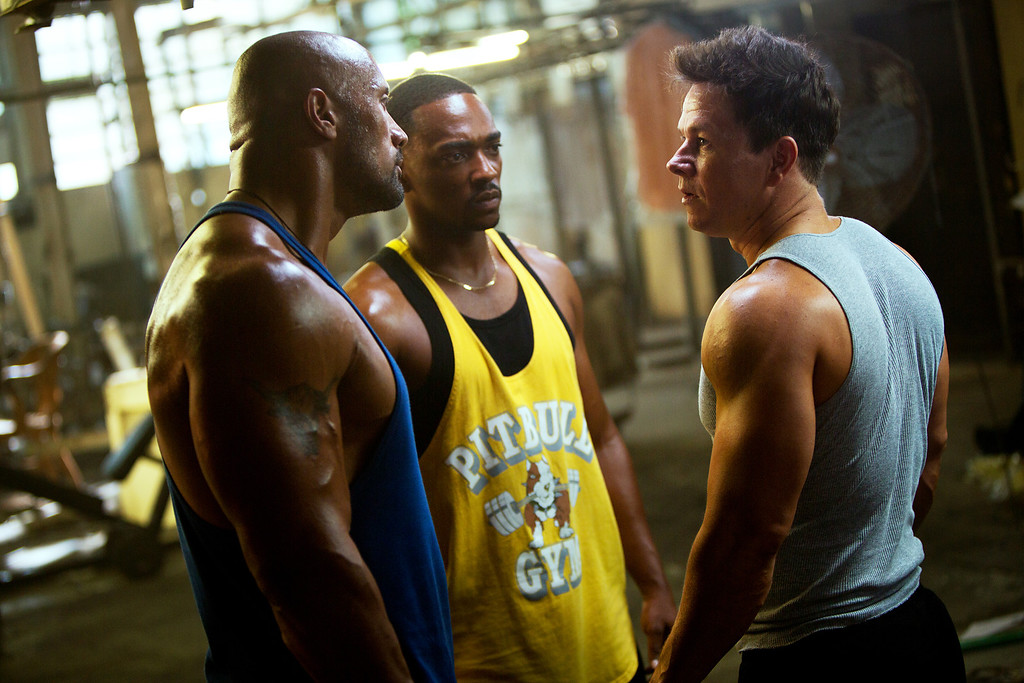 ". This film image released by Paramount Pictures shows, from left, Dwayne Johnson, Anthony Mackie and Mark Wahlberg in a scene from ""Pain and Gain.\"" (AP Photo/Paramount Pictures, Jaime Trueblood)"