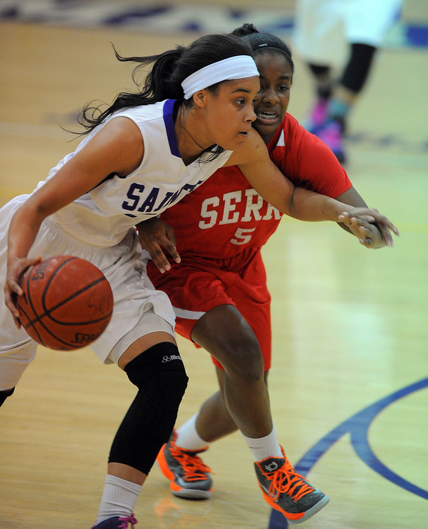 . LONG BEACH - 02/20/13 - (Photo: Scott Varley, Los Angeles Newspaper Group)  Serra and St. Anthony meet in the Quarterfinals of the Division 4AA CIF-SS girls basketball playoffs. St. Anthony\'s Jordan Jackson tries to get by Brooke Bayman.