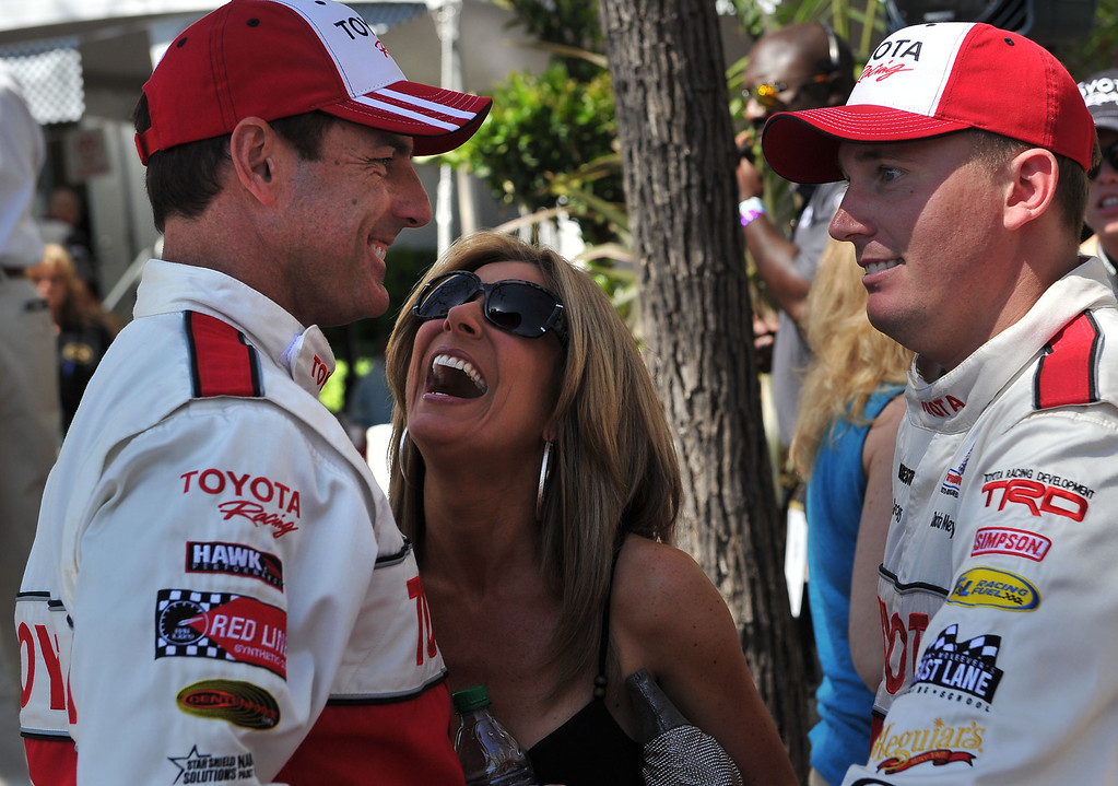 . 4/19/13 - Mark Steines and Dakota Meyer share a laugh after the Friday morning practice of the Toyota Pro/Celebrity race at the 39th Annual Toyota Grand Prix of Long Beach. Photo by Brittany Murray / Staff Photographer