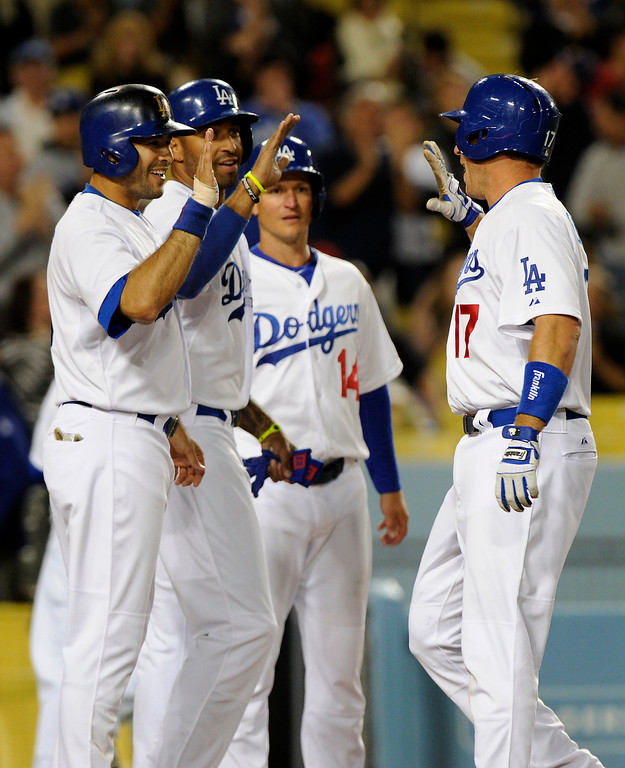 . The Dodgers A.J. Ellis, right, is greeted at home by Andre Ethier, from left, Matt Kemp and Mark Ellis after hitting a grand slam in the first inning against the Angels, Friday, March 29, 2013, at Dodger Stadium. (Michael Owen Baker/Staff Photographer)