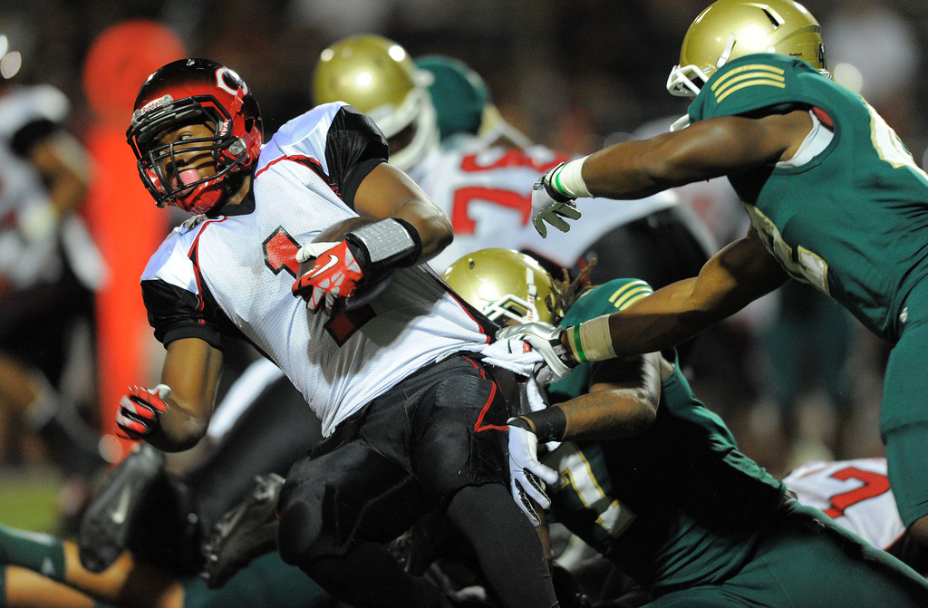 . Long Beach Poly football takes on Centennial (Corona) as part of the Mission Viejo Classic in Mission Viejo, CA on Friday, September 13, 2013. Centennial\'s Tre Watson is stopped for a short gain. (Photo by Scott Varley, Press-Telegram)