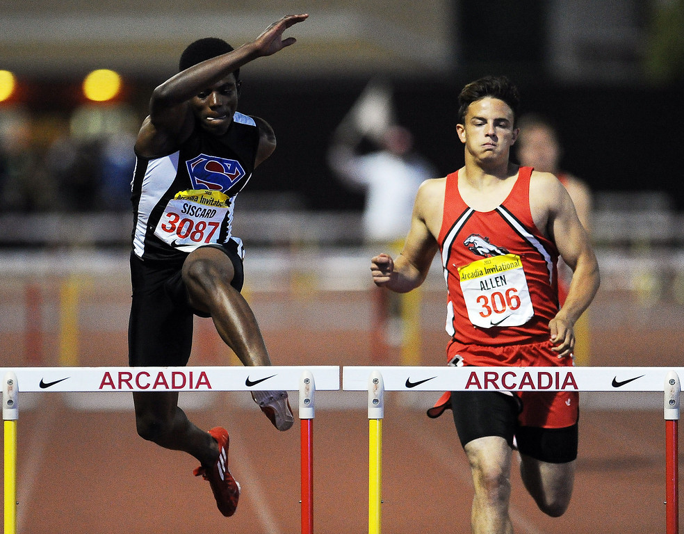 Description of . Serra's Lloyd Siscard wins the 300 meter hurdles invitational during the Arcadia Invitational at Arcadia High School on Saturday, April 6, 2013 in Arcadia, Calif.  (Keith Birmingham Pasadena Star-News)