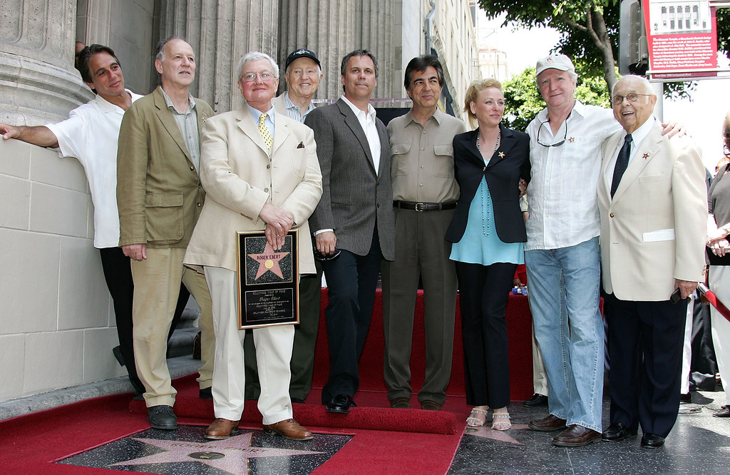 . LOS ANGELES - JUNE 23:  Movie Critic Roger Ebert (3rd-L) stands with guests, including (L-R) actor Tony Danza, director Werner Herzog, critic Robert Roper, actor Joe Mantegna, actress Virginia Madsen and Johnny Grant, honorary mayor of Hollywood as Ebert receives the 2,288th Star on the Hollywood Walk of Fame on June 23, 2005 in Hollywood, California.  (Photo by Frazer Harrison/Getty Images)