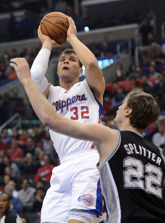 . The Clippers\' Blake Griffin #32 shoots as the Spurs\' Tiago Splittern #22 defends during their game at the Staples Center in Los Angeles Friday, February  21, 2013. (Hans Gutknecht/Staff Photographer)