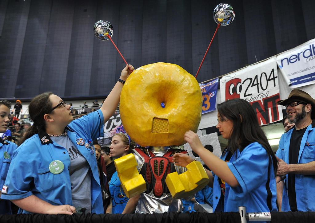 . 3/22/13 - Team Bagel Bytes from Culver City High School tend to their mascot while watching the robotic competition on Friday morning. More than 1,500 high school students from California, Hawaii and Chile are competing in the 22nd FIRST Robotics Los Angeles Regional Competition at the Long Beach Arena.This years robotic task is throwing discs for points. Photo by Brittany Murray / Staff Photographer