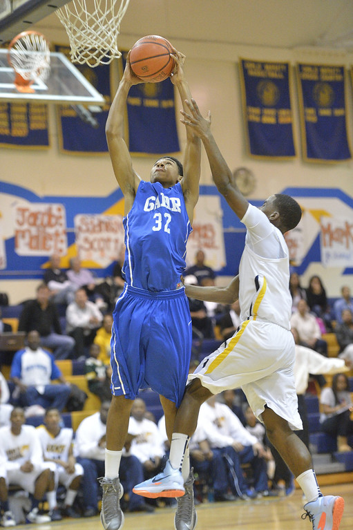 . LONG BEACH, CALIF. USA -- Gahr\'s David Murrell (32) takes a shot against Millikan\'s Mark Thomas (11) during their CIF-SS Divison 1-A playoff game in Long Beach on February 15, 2013. Millikan defeated Gahr, 74 to 64. Photo by Jeff Gritchen / Los Angeles Newspaper Group