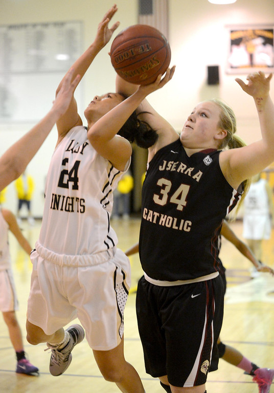 . Bishop Montgomery\'s Sophia Song  (24) drives to the basket against JSerra\'s Courtney Vaccher (34) in a CIF Division IV-AA quarterfinal game Wednesday night in Torrance. 20130220 Photo by Steve McCrank / Staff Photographer
