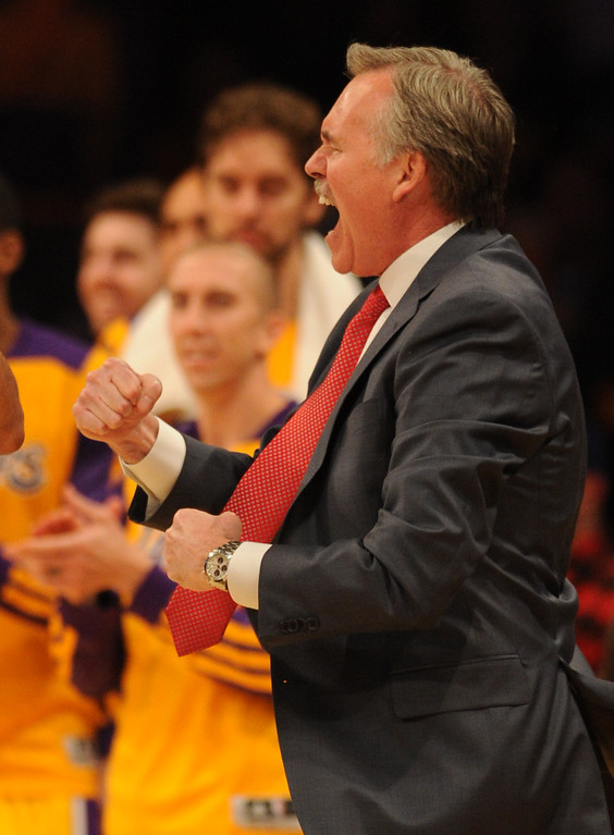 . Lakers Heads Coach Mike D\'Antoni celebrates in the 4th quarter. The Los Angeles Lakers defeated the Clippers 116 to 103 in the opening game of the season at Staples Center. Los Angeles, CA. 10/29/2013. photo by (John McCoy/Los Angeles Daily News)