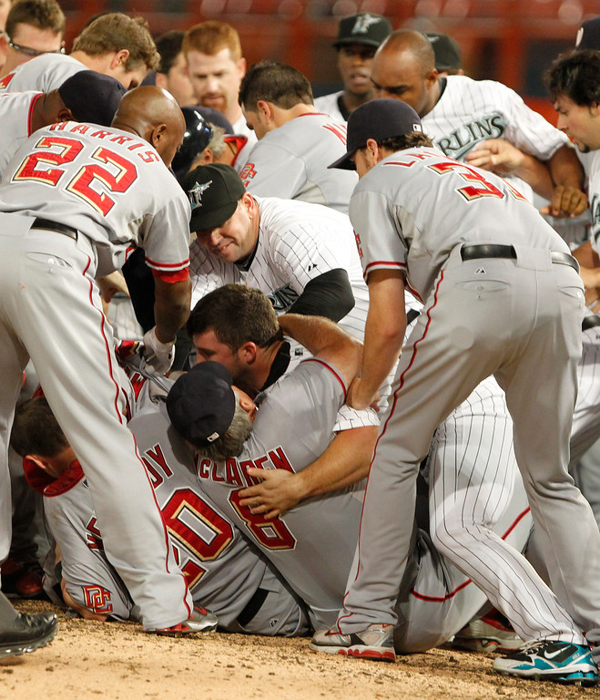 . Florida Marlins and Washington Nationals players fall to the ground during a brawl in the sixth inning of a baseball game Wednesday, Sept. 1, 2010 in Miami. Nationals\' Nyjer Morgan charged the mound after a pitch from Florida\'s Chris Volstad sailed behind him. (AP Photo/Wilfredo Lee)
