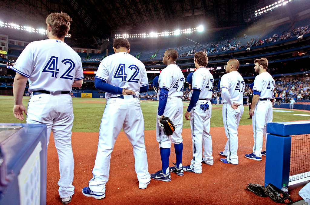 Description of . TORONTO, CANADA - APRIL 15: The Toronto Blue Jays stand for the National Anthem before action against the Baltimore Orioles during MLB action at the Rogers Centre April 15, 2012 in Toronto, Ontario, Canada. Both teams wore the number 42 in honor of Jackie Robinson Day. (Photo by Abelimages/Getty Images)
