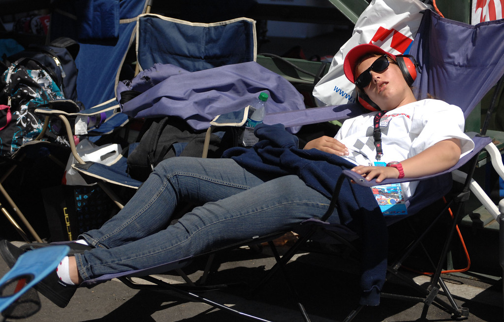 . 04/20/13 - A volunteer succumbs to the heat with a nap at the 39th Annual Toyota Grand Prix of Long Beach. Photo by Brittany Murray / Staff Photographer