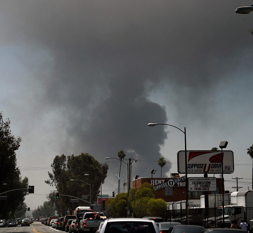 . Atwater Village July 13,2013. A huge black header of black smoke could be seen for miles as fuel spills into the LA river. A tanker truck flipped and caught fire in a tunnel beneath a major freeway interchange north of downtown Los Angeles today, causing a major traffic jam, fuel spill into the Los Angeles River and a hazardous smoke scare. Photo by Gene Blevins/LA Daily News