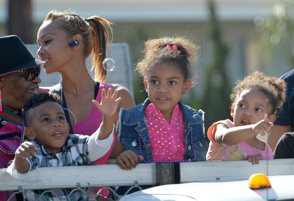 . The 26th Annual Martin Luther King, Jr., Peace & Unity Parade Saturday, January 18, 2014, Long Beach, CA.   Children in the parade become enthralled with bubbles being blown along the route. Photo by Steve McCrank/Daily Breeze