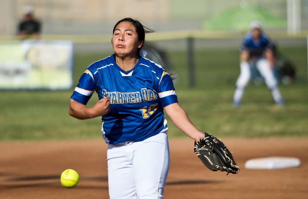Description of . Charter Oak's pitcher Kaile Chavez during San Dimas Softball tournament game, Glendora vs. Charter Oak at Charter Oak High School in Covina on Monday, March 4, 2013. Charter Oak beat Glendora 9-1. (SGVN/Staff photo by Watchara Phomicinda)