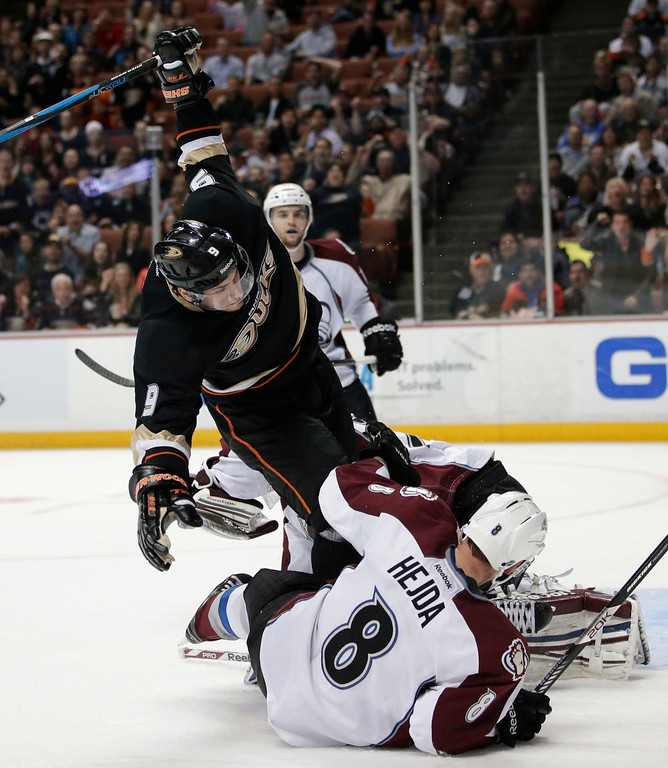 . Anaheim Ducks\' Bobby Ryan, top, and Colorado Avalanche\'s Jan Hejda, of the Czech Republic, fall to the ice during the second period of an NHL hockey game in Anaheim, Calif., Wednesday, April 10, 2013. (AP Photo/Jae C. Hong)
