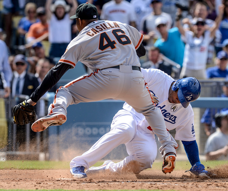 . Dodger\'s Carl Crawford scores as Giant\'s Santiago Casilla can\'t make the play at home plate during the 8th inning during opening day at Dodger Stadium Monday.  Dodgers defeated the Giants 4-0.  Photo by David Crane/Los Angeles Daily News.