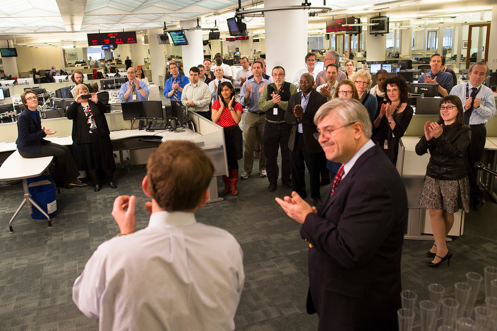 . Members of the Associated Press Headquarters newsroom applaud the announcement of the 2013 Pulitzer Prize winners, Monday, April 15, 2013, in New York. Associated Press photographers Rodrigo Abd, Manu Brabo, Narciso Contreras, Khalil Hamra, and Muhammed Muheisen won the 2013 Pulitzer Prize for Breaking News Photography for their work covering the Syrian civil war. (AP Photo/John Minchillo)