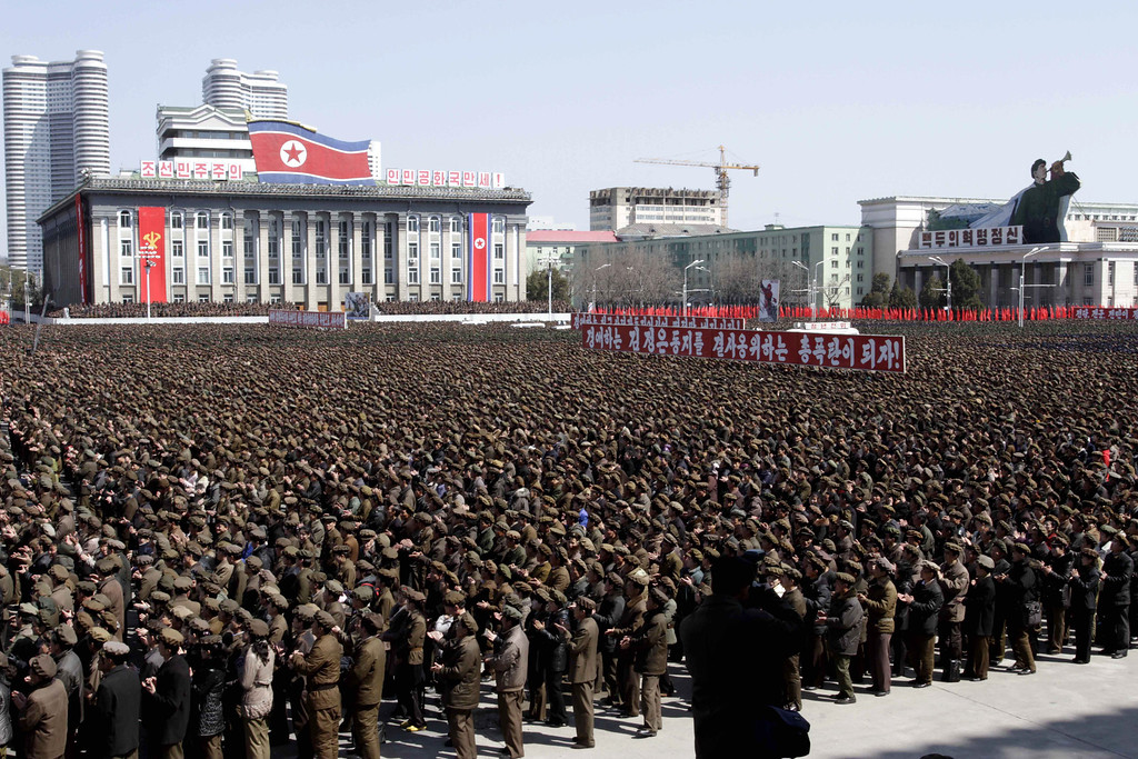 . North Koreans gather at a rally at Kim Il Sung Square in downtown Pyongyang, North Korea, Friday, March 28, 2013. Thousands of North Koreans turned out for the mass rally at the main square in Pyongyang in support of their leader Kim Jong Un\'s call to arms. (AP Photo/Jon Chol Jin)