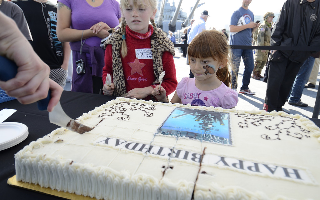 . SAN PEDRO, CALIF. USA -- Pip Fabian, left, and Neve Holcomb wait for their cake during the 70th. birthday celebration of the USS Iowa in San Pedro, Calif. on February 17, 2013. Photo by Jeff Gritchen / Los Angeles Newspaper Group