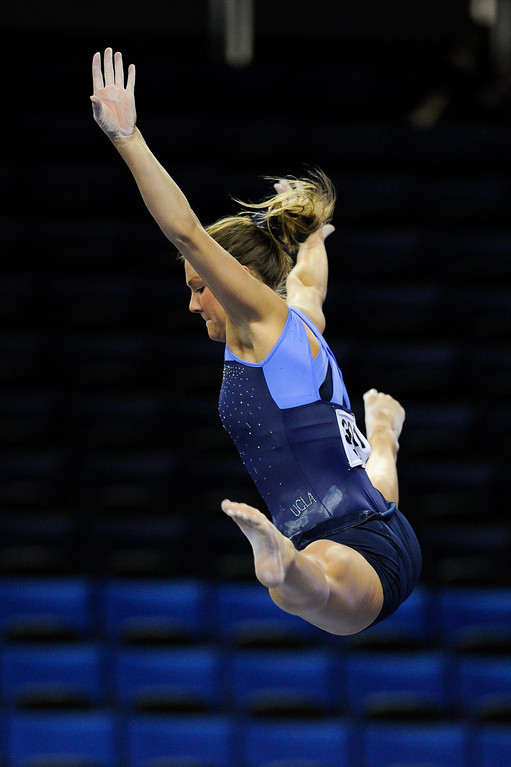 . UCLA\'s Kaelie Baer practices on the beam, Thursday, April 18, 2013, for the upcoming NCAA Women\'s Gymnastics Championships at Pauley Pavilion. (Michael Owen Baker/Staff Photographer)