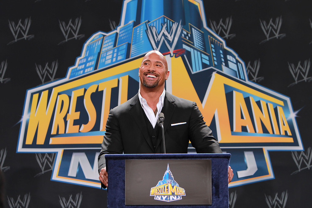 ". World Wrestling Entertainment personality Dwayne ""The Rock\"" Johnson speaks at a news conference in East Rutherford, N.J., Thursday, Feb. 16, 2012, to announce that MetLife Stadium will host WrestleMania XXIX on April 7, 2013. (AP Photo/StarPix, Dave Allocca)"