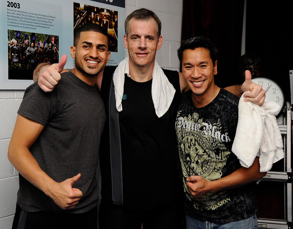 . (L-R) Raul Garcia , Actor/stuntman Ron Sarchian and Ky Gray pose together after Ron Sarchian set a new Guinness world record by full contact kicking a bag 6,000 times in one hour and did it by 6,012 at the Martial Arts History Museum in Burbank. 