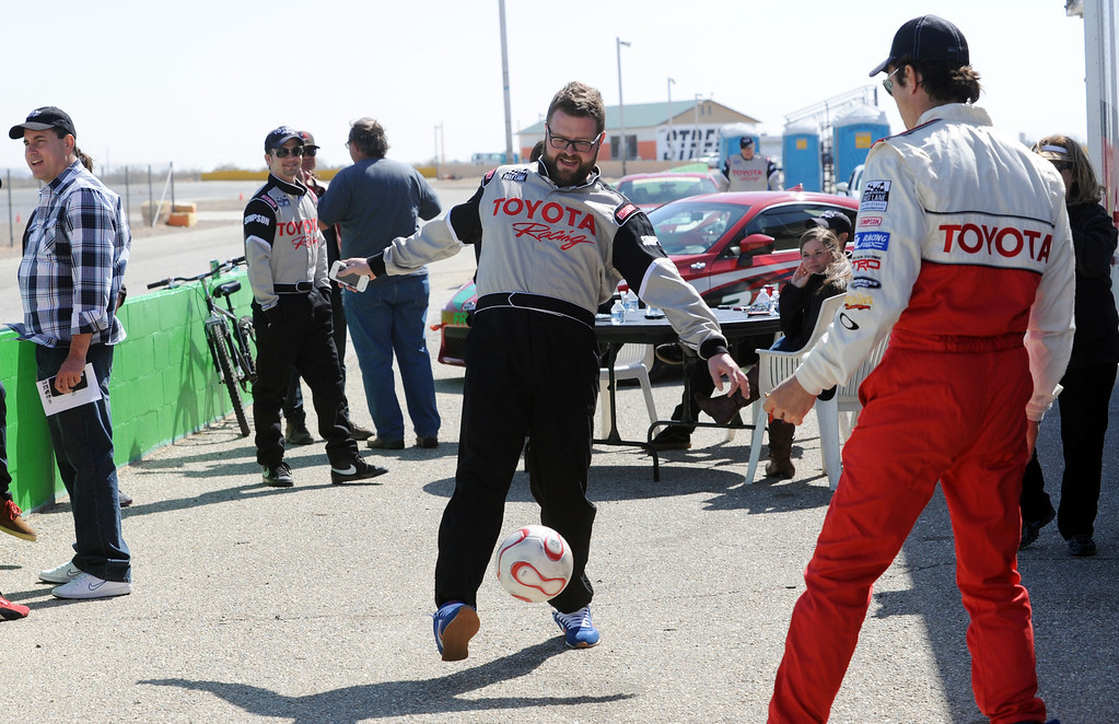 """. Rosamond, Calif., -- 03-23-13-  Toyota Pro/ Celebrity Race participants co-host of \""""Top Gear \"""" Rutledge Wood and actor Michael Trucco loosen up with some soccer, during a practice session at Willow Springs Raceway. The Toyota Pro/Celebrity Race helps raise money on behalf of Racing for Kids, a fundraising program benefiting Miller Children�s Hospital in Long Beach and Children�s Hospital of Orange County. On behalf of the race and its participants, Toyota has donated more than $2 million to various children�s hospitals since 1991.  Stephen Carr/  Los Angeles Newspaper Group"""