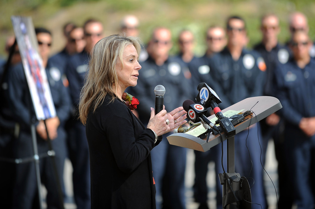 . Karen Langley-Stephen (Mother of Jeff Langley) speaks during the 20th Anniversary Memorial Ceremony for firefighter Jeff Langley March 28, 2013 at the Los Angeles County Fire Department Barton Heliport in Pacoima, CA.  Langley was killed during a 1993 Air Operations rescue in Malibu.(Andy Holzman/Staff Photographer)