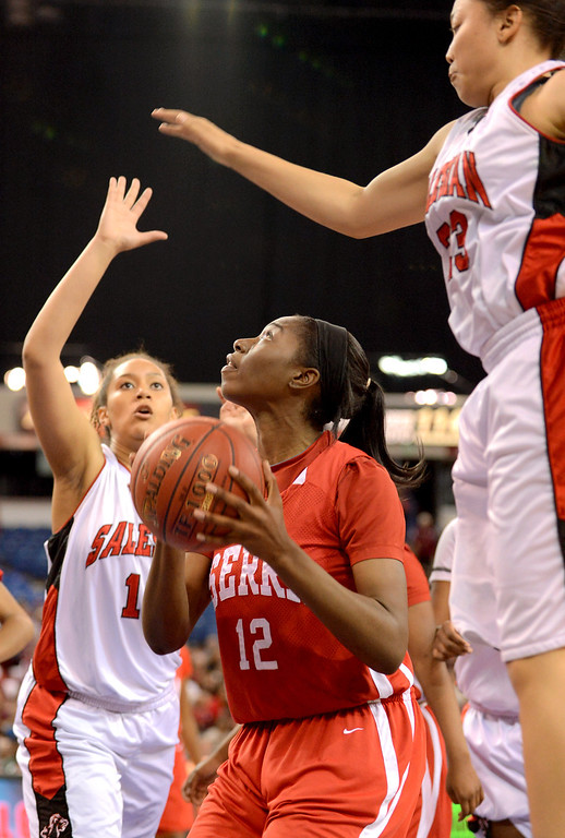 . Serra High School\'s Tatiana Howard looks for an open shot against Salesian High during the Division IV 2013 CIF State Basketball Championships at Sleep Train Arena, in Sacramento, Ca March 23, 2013.  Serra won the game 62-60.(Andy Holzman/Los Angeles Daily News)